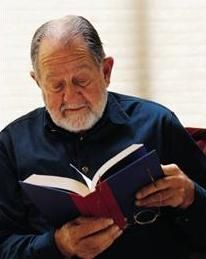 Older gentleman reading a book