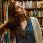 Woman looking at library books