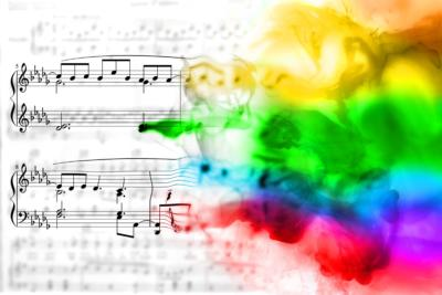 image of sheet music and colorful paints