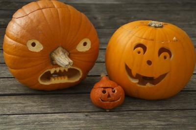 Images of three pumpkins carved into jack-o-lanterns