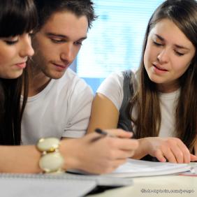 Image of teens working together on homework